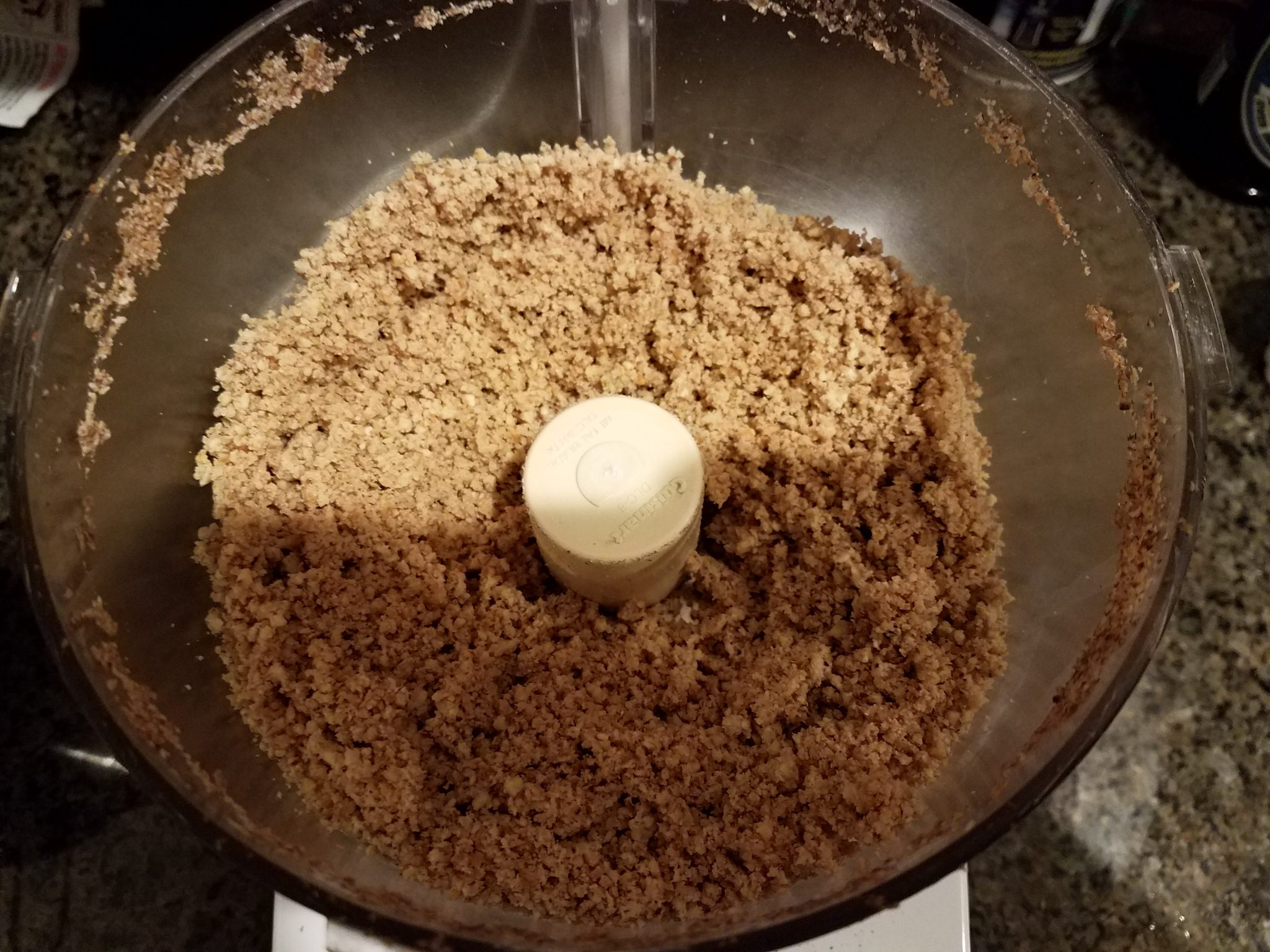 4 - Put the Tiger Nuts into the food processor and run it until they are finely chopped into very small pieces
